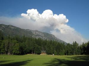 Blue skies at the Ranch with the smoke plume in the Background